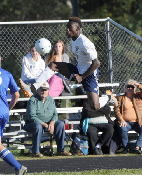 Zidane McMurrin leaps into the air to stop the ball in the Panthers 2-0 win over Morse.  (Paula Roberts photo)