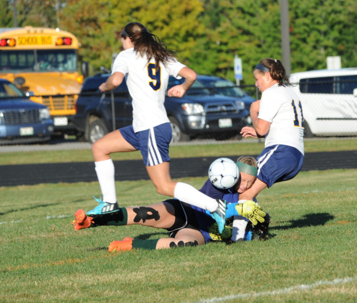 Abby Nelson and Hallie Kunesh pressure Leavitt keeper Shelby Varney. (Paula Roberts photo)