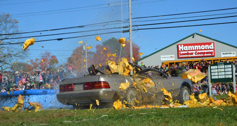 After a 145-foot drop, a pumpkin smashes into a Lexus during the final event of the 2016 Damariscotta Pumpkinfest on Monday, Oct. 10. (Maia Zewert photo)