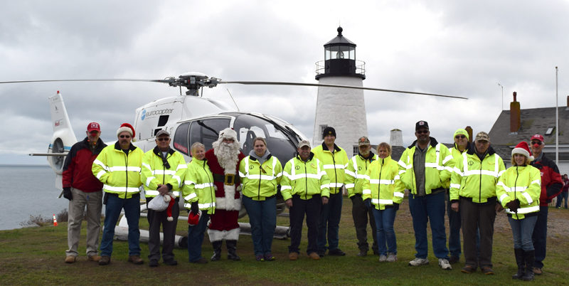 Bristol firefighters and first responders pose with Santa Claus and the Flying Santa crew during their visit to Pemaquid Point Lighthouse Park on Sunday, Nov. 27. (J.W. Oliver photo)
