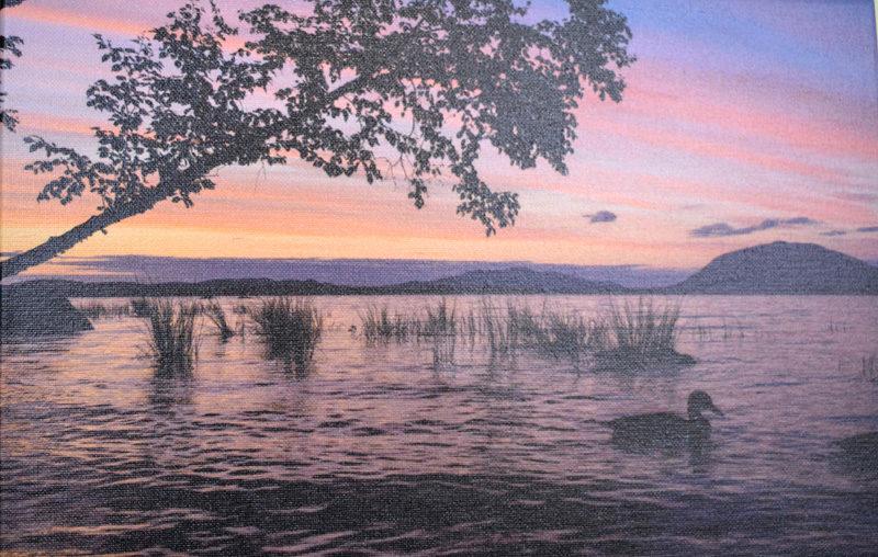 """Sunset on Spencer Bay - Moosehead,"" a photograph on canvas by Kate Coupland. (Christine LaPado-Breglia photo)"