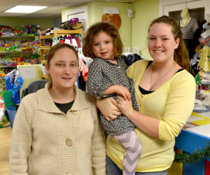 From left: Karie Manning, Annabelle Waltz, and Liz Waltz stand in The Kidz Closet at 127 Elm St. in Damariscotta. Liz Waltz purchased the business Nov. 12 and, with the help of friends, like Manning, and family, has been preparing for the store's reopening Thursday, Dec. 1. (Maia Zewert photo)