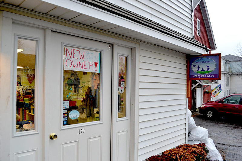 A sign on the door of The Kidz Closet, at 127 Elm St. in Damariscotta, announces the business's reopening under new management Thursday, Dec. 1. (Maia Zewert photo)