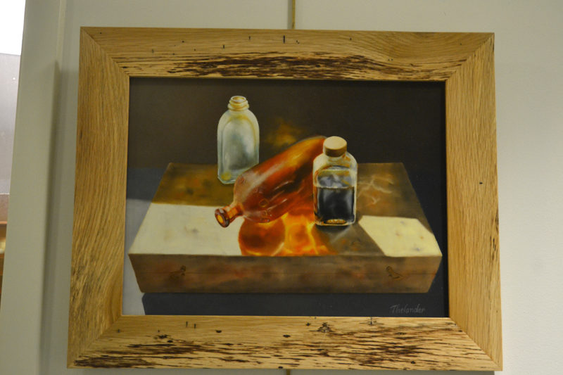 """What's in the Box?"" is a meticulously created oil painting by Liliana Thelander, one of a number of her paintings on display in The Carey Gallery at Skidompha Public Library through Saturday, Dec. 31. (Christine LaPado-Breglia photo)"