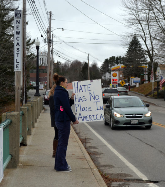 "Rebekah Oliver, of Damariscotta, holds a sign that reads ""hate has no place in America"" on the Damariscotta-Newcastle bridge Saturday, Nov. 26. Oliver started the peaceful demonstrations after the election. (Maia Zewert photo)"