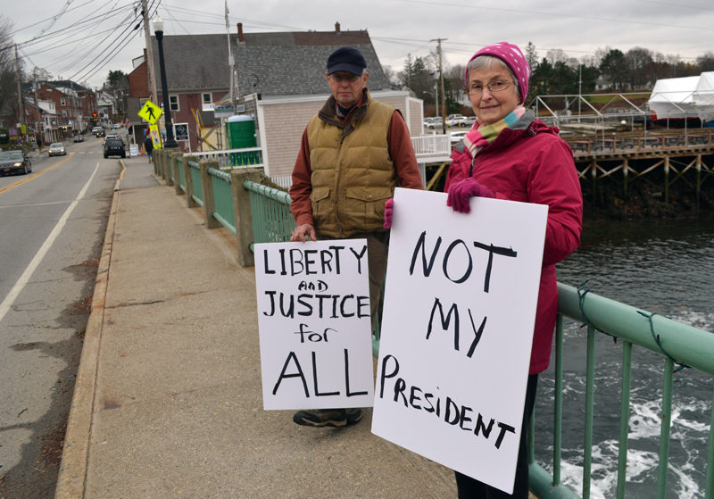 "John and Carol Hartman, of Newcastle, particpate in a peaceful demonstration on the Damariscotta-Newcastle bridge Saturday, Nov. 26. ""This was our first attempt at expressing our opinion loudly and proudly,"" Carol Hartman said. (Maia Zewert photo)"