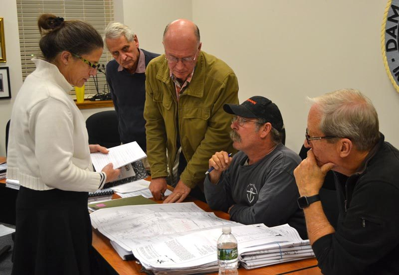 From left: Stepping Stone Housing Inc. Executive Director Marilee Harris presents the nonprofit's plan for a transitional housing development in Damariscotta to Town Planner Tony Dater and Damariscotta Planning Board members Stephen Cole, Jonathan Eaton, and Bruce Garren on Monday, Nov. 14. (Maia Zewert photo)