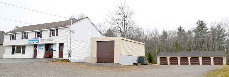 Stepping Stone Housing Inc. recently purchased a 1.8-acre property at 53 and 57 Biscay Road in Damariscotta. The property includes a commercial rental space, a six-bay garage, and a two-bedroom house (obscured). (Maia Zewert photo)