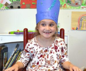 Willow Shadis, of Damariscotta, wears a crown celebrating her 7th birthday at Coastal Kids Preschool in Damariscotta. (Maia Zewert photo)