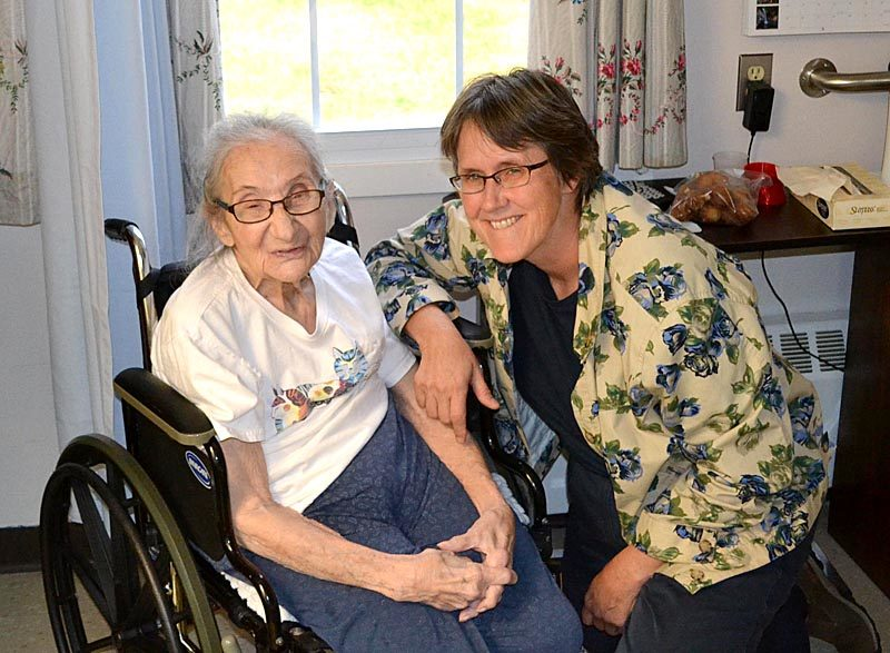 Sarah Cheiker (left) and her conservator, Linda Russell, in Cheiker's room at the Fryeburg Health and Residential Care Center in Fryeburg on Oct. 13. Cheiker has lived at the nursing home as a MaineCare patient since she was defrauded of nearly $1 million and abandoned in a cabin in Edgecomb in 2011. (Abigail Adams photo)
