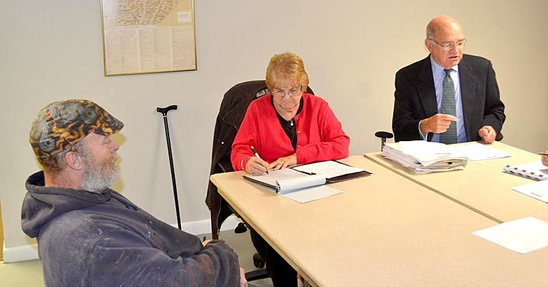 Timothy Stephenson (left) looks on as Edgecomb town attorney Bill Dale (right) speaks and Sherry Tibbetts takes minutes at the Edgecomb Board of Selectmen's Monday, Nov. 9 meeting. (Abigail W. Adams photo)