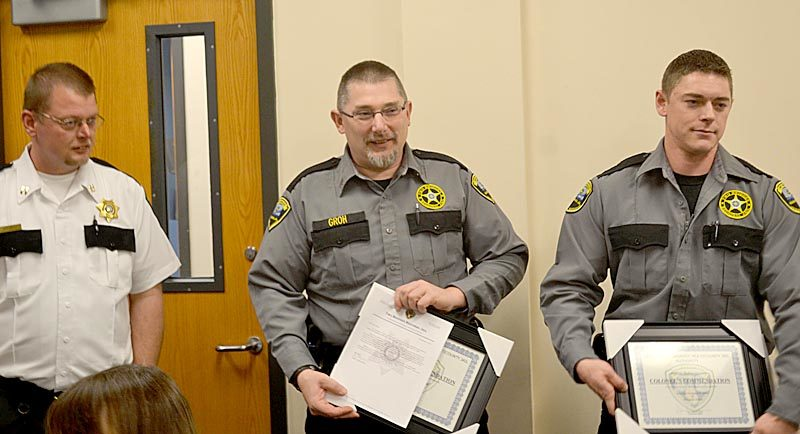 From left: Capt. James Bailey presents a Colonel's Commendation to Darryl Groh and Dylan Quimby at Two Bridges Regional Jail in Wiscasset on Wednesday, Nov. 9. The commendations recognize the officers for their role in saving an inmate's life in October. (Abigail Adams photo)