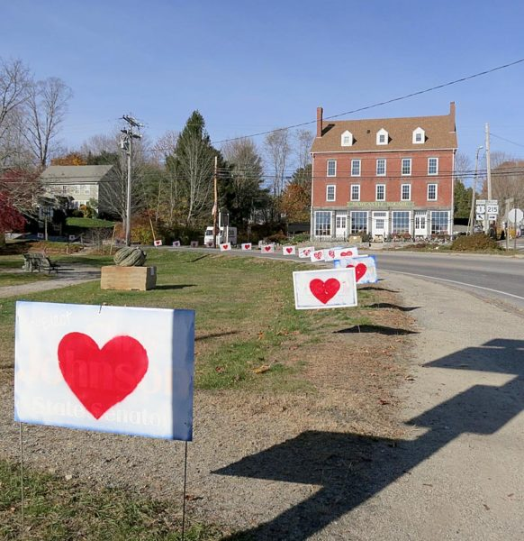 Campaign signs bearing hearts line Main Street in Newcastle next to Veterans Memorial Park the morning of Thursday, Nov. 10. (Photo courtesy Chris Johnson)