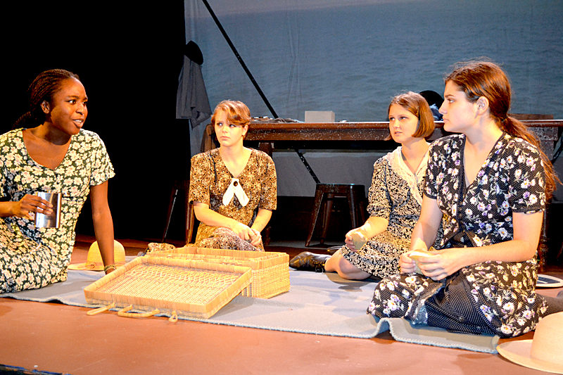 "From left: Lincoln Academy students Toru Fiberesima, Rachael Schuster, Thalia Eddyblouin, and Noelle Timberlake play Pearl, Frances, Catherine, and Charlotte, respectively, in a dress rehearsal of the powerful Melanie Marnich play ""These Shining Lives"" at the Parker B. Poe Theater. (Christine LaPado-Breglia photo)"