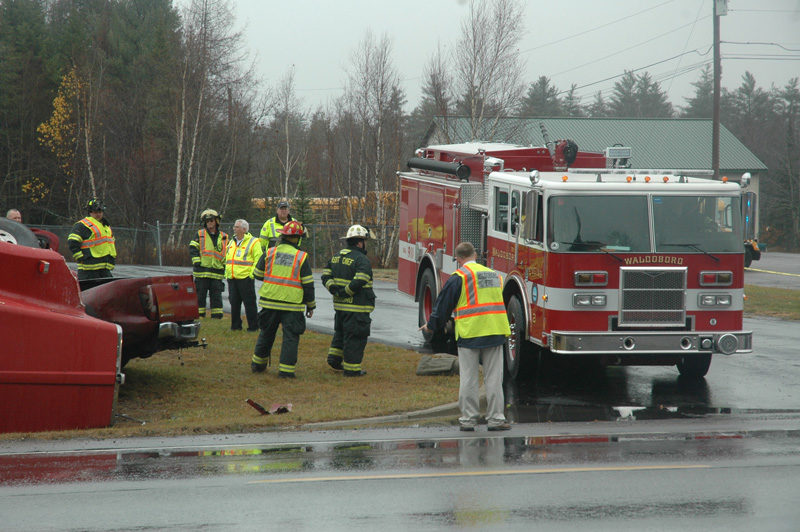 Waldoboro firefighters work at the scene of a fatal accident on Route 1 the morning of Wednesday, Nov. 16. (Alexander Violo photo)
