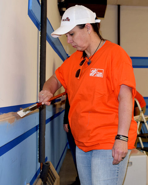Team Depot member Tina Campbell paints at the American Legion in Waldoboro. Campbell works at The Home Depot's Waterville store and asked for the day off to join other volunteers at the Legion post. (J.W. Oliver photo)