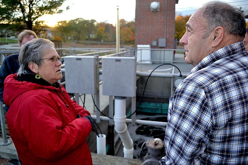 Wiscasset Selectman Judy Flanagan (left) and Wiscasset Wastewater Treatment Plant Superintendent Buck Rines stand in front of an aeration tank on Monday, Oct. 24. The tank was the subject of a problem at the plant that may result in a fine from the Maine Department of Environmental Protection. (Abigail Adams photo)