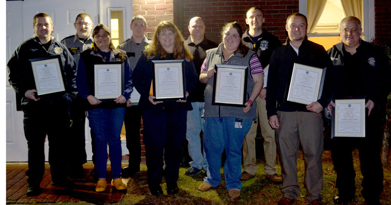 The participants in an emergency call that saved a Two Bridges Regional Jail inmate's life, back from left: Darryl Groh, Dylan Quimby, Kaleb Colbry, and James Pray. Front: Jacob Williams, Sonia Lilly, Wendy Williams, Emily Snowman, T.J. Merry, and Michael Williams. Not pictured: Dan Averill and Shaun Robinson. (Abigail Adams photo)