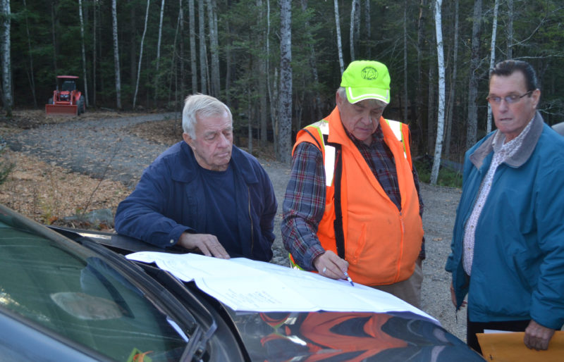 From left: Wiscasset Planning Board Chair Ray Soule, surveyor Karl Olson, and board member Lester Morse review an application for modifications to four lots in the Clark's Point Development subdivision plan during a site walk Thursday, Nov. 17. (Abigail Adams photo)