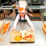 First-Graders Have Fun Working in Cafeteria