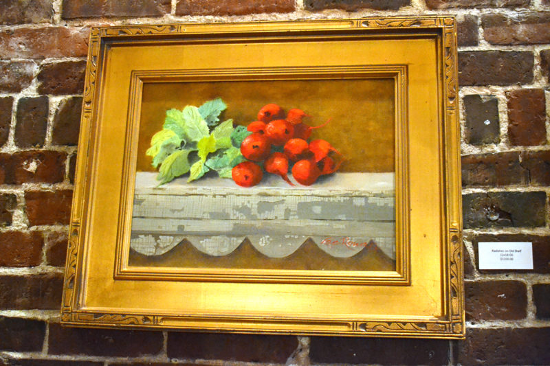 """The color red pops in Lee Rowan's oil painting """"Radishes on Old Shelf."""" (Christine LaPado-Breglia photo)"""