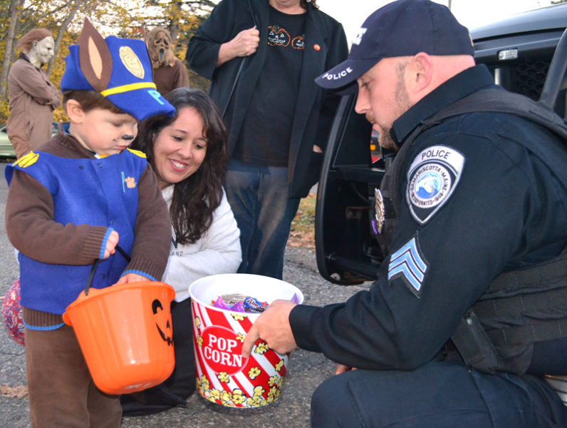 Nicholas Kupstas Jr., of Newcastle, collects candy from Sgt. Jason Warlick during a trunk-or-treat event at the Damariscotta Police Department on Halloween. The department recently received a $600 donation for the event from a Texas man after returning the man's wallet with more than $1,200 inside. (Maia Zewert photo, LCN file)