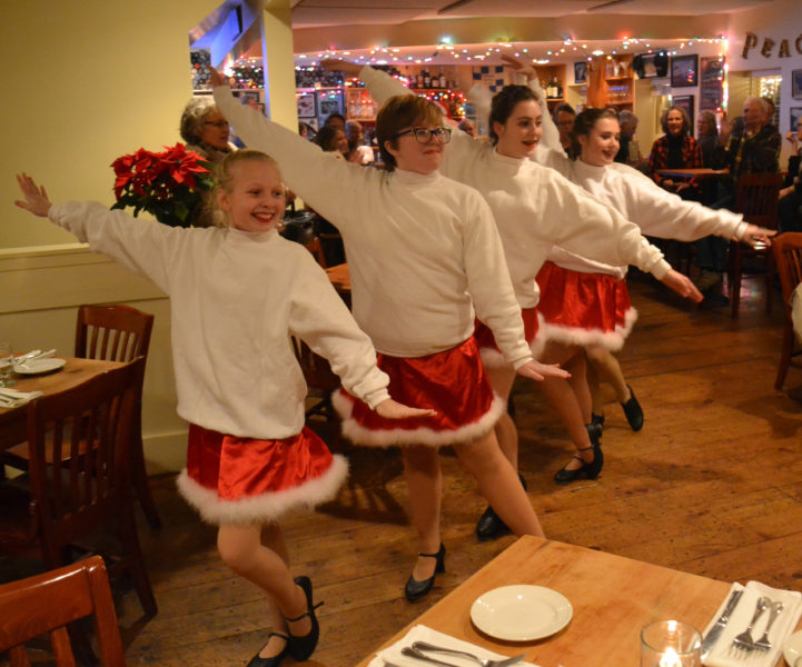The Renys Rockets put on a show at the Damariscotta River Grill as part of the 10th annual Wrap It Up street festival Thursday, Dec. 22. (Abigail Adams photo)