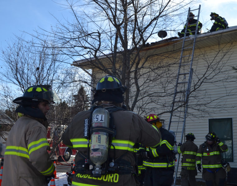 Firefighters from Jefferson, Nobleboro, Somerville, Waldoboro, and Whitefield responded to 252 East Pond Road after a chimney fire spread to the space between the flue liner and brick of the chimney on Sunday, Dec. 11. Crews worked on each floor of the house and the roof to extinguish the remaining heat, according to Jefferson Fire Chief Walter Morris. (Maia Zewert photo)