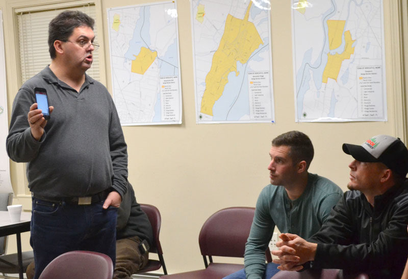 From left: Bristol firefighter Daniel MacWalters explains the I Am Responding app to Newcastle firefighters Luke Velho and Patrick Lizotte during a presentation Tuesday, Dec. 13. (Maia Zewert photo)