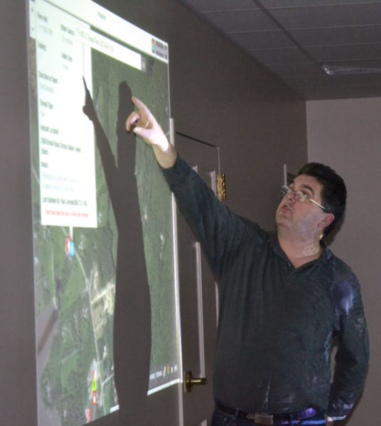 Bristol firefighter Daniel MacWalters explains how I Am Responding can map the fastest route to an emergency scene during a presentation to Newcastle firefighters Tuesday, Dec. 13. (Maia Zewert photo)