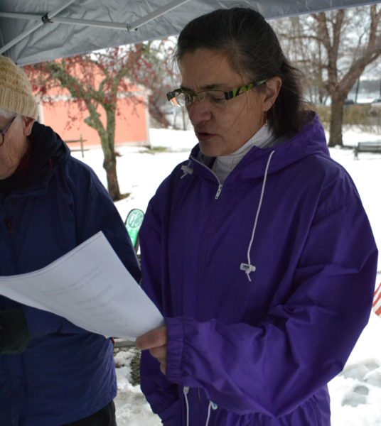 Damariscotta Baptist Church Pastor Marilee Harris reads a prayer for the homeless during a service at Veterans Memorial Park in Newcastle the afternoon of Sunday , Dec. 18. (Maia Zewert photo)