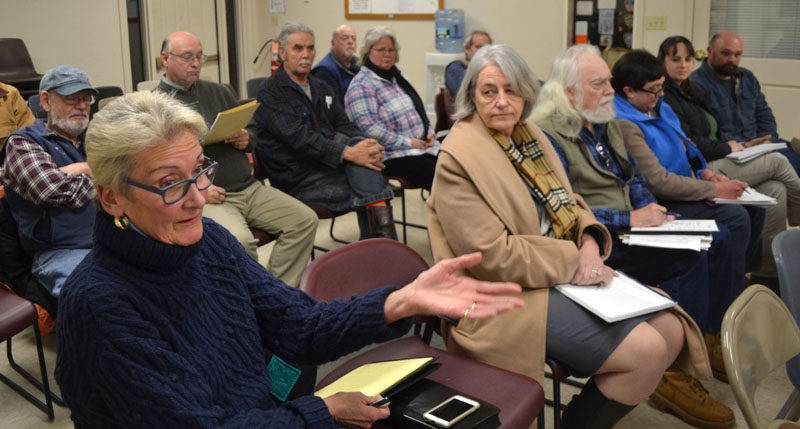 Marva Nesbit, one of the landowners whose property abuts Sherman Marsh in Newcastle, asks a question during a meeting with Maine Department of Transportation officials Monday, Dec. 12. (Maia Zewert photo)