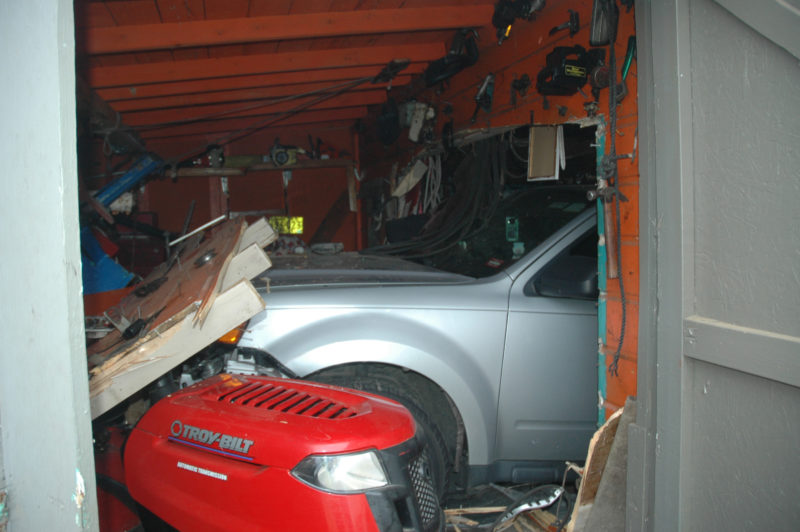 A gray Ford SUV crashed through a garage door and continued through much of the building on Upper East Pond Road in Nobleboro the afternoon of Friday, Dec. 2. (Alexander Violo photo)