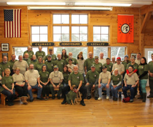 A group photo of the Vietnam War veterans who attended a week-long camp at Camp Kieve in Nobleboro Dec. 5-9, with guests and volunteers. (Photo courtesy Russ Williams)