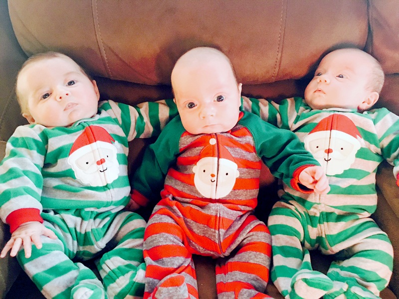 From left: South Bristol triplets Chloe, Camden, and Ainsley Merrill are ready for Christmas in their matching Santa Claus pajamas. Parents Amanda Sykes and Shane Merrill and big sister Avalee Brightman-Uhl welcomed the triplets Sept. 18. (Photo courtesy Amanda Sykes)