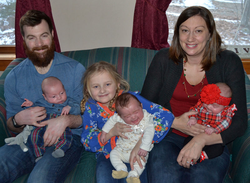 After spending 50 days in the neonatal intensive care unit in Portland, triplets (from left) Camden, Chloe, and Ainsley Merrill are home in South Bristol with parents Shane Merrill and Amanda Sykes and sister Avalee Brightman-Uhl. (Maia Zewert photo)