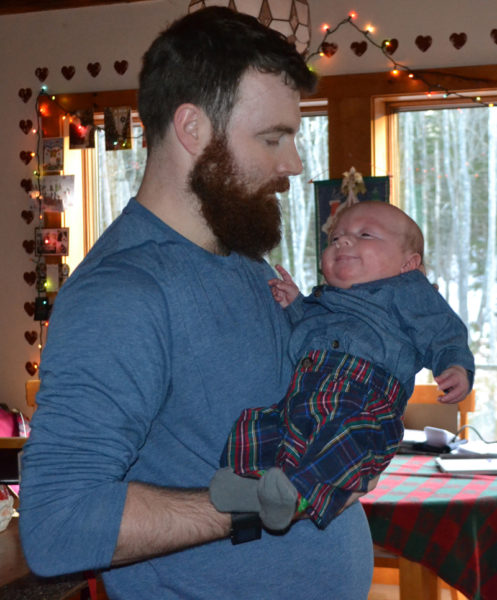 Shane Merrill holds his son, Camden Merrill, in his home in South Bristol. Merrill's fiancee, Amanda Sykes, gave birth to triplets Sept. 18. (Maia Zewert photo)