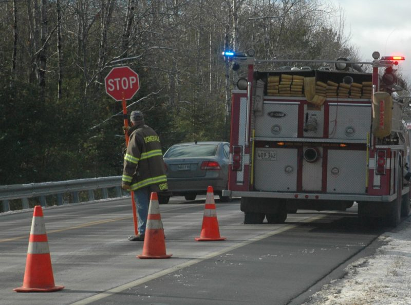 A member of the Somerville Fire Department conducts traffic control near the scene of a woods accident off of Route 17 on Friday, Dec. 9. (Alexander Violo photo)