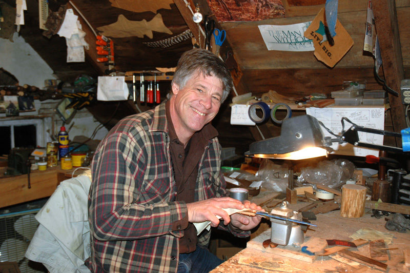 Michael Stenstrom works on one of his custom knifes in his workshop in Waldoboro. The outdoorsman makes the knives from scratch, even milling the wood for the handles. (Alexander Violo photo)