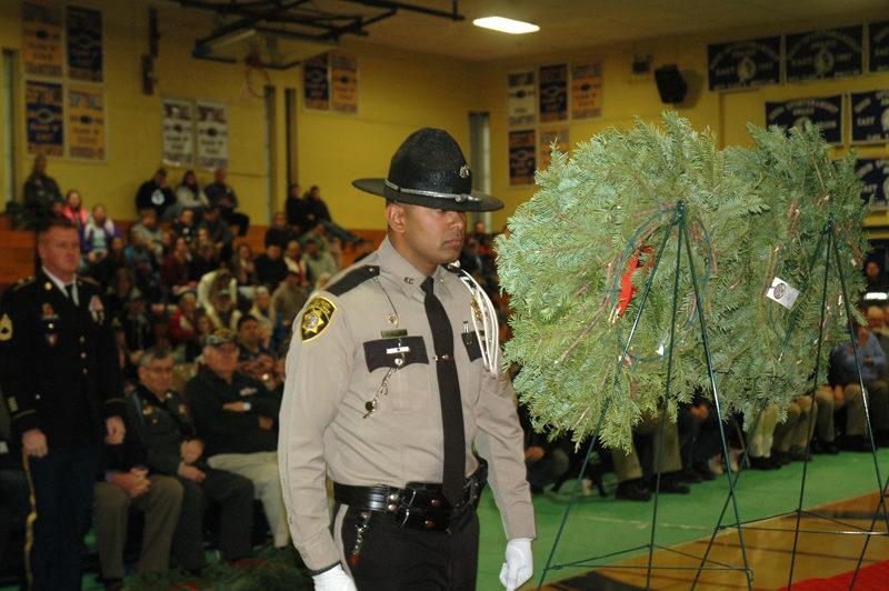Knox County Sheriff's Deputy Nathaniel Jack prepares to present a wreath. (Alexander Violo photo)