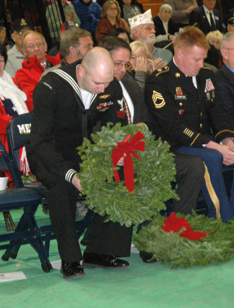 Veteran Justin Woods accepts a wreath during the Wreaths Across America ceremony at Medomak Valley High School in Waldoboro on Sunday, Dec. 11. (Alexander Violo photo)