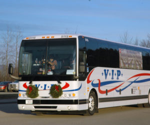 A bus carrying gold star and blue star families arrives for the Wreaths Across America ceremony at Medomak Valley High School in Waldoboro on Sunday, Dec. 11. (Alexander Violo photo)