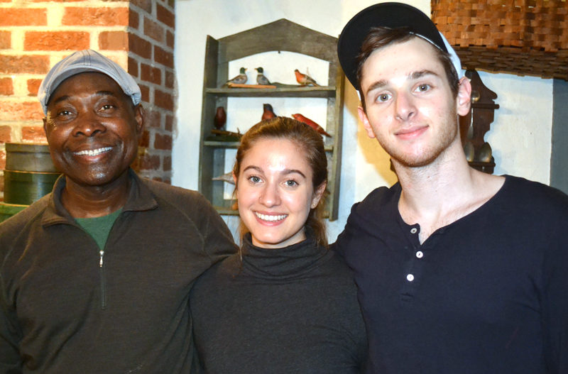 From left: Messan Jordan Benissan, Tristan Friedman, and Theo Satloff prepared a four-course meal of traditional Togolese cuisine for Wiscasset Area Chamber of Commerce members Thursday, Dec. 8. (Abigail Adams photo)