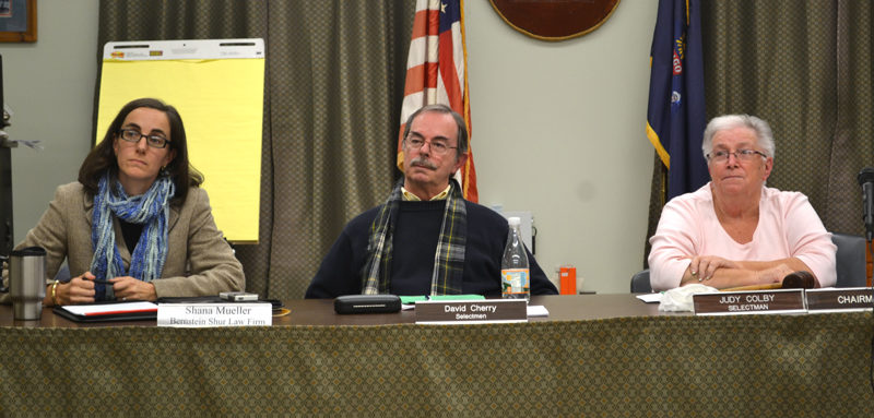 From left: Wiscasset town attorney Shana Mueller, Selectman David Cherry, and Chair Judy Colby listen to school committee members respond to the formal objection the Wiscasset Board of Selectmen will send to the contractors and financial institutions involved with the school's energy contract Tuesday, Dec. 20. (Abigail Adams photo)
