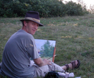 Douglas Smith paints on Marsh Island.