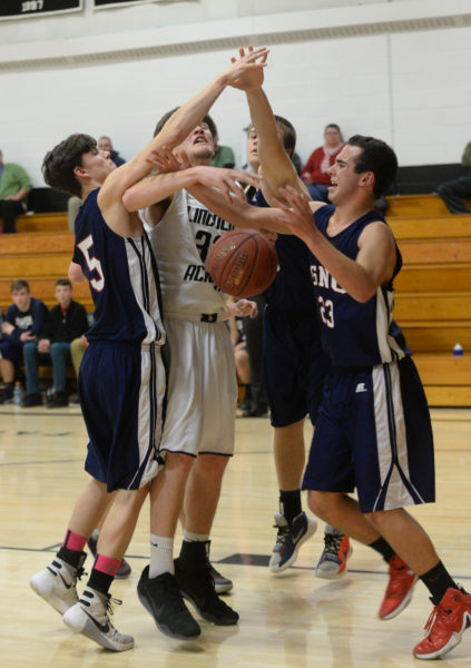 Cody Tozier gets hammered on this shot attempt. (Paula Roberts photo)