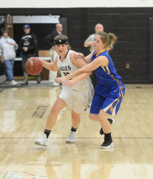 Cagney O'Brien brings the ball up the court in the Lady Eagles win over Lake Region. (Paula Roberts photo)