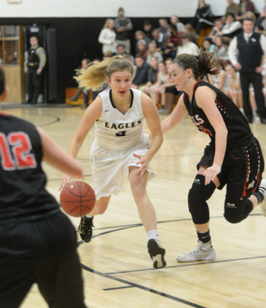 Brie Wajer looks for an open Eagle teammate as she drives inside. (Paula Roberts photo)