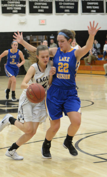 Chelsea Williams draws contact but no foul while driving to the hoop after stealing the ball. (Paula Roberts photo)