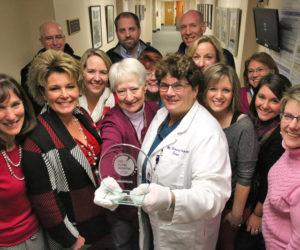 LincolnHealth hospital managers, clinical staff, and employees celebrate LincolnHealth's receipt of the Top Rural Hospital award from The Leapfrog Group on Thursday, Dec. 8.